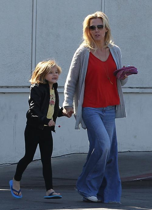 Jenny Garth, wearing some very big bell bottoms, signs up her daughter for the new soccer season after getting their nails done in Los Angeles